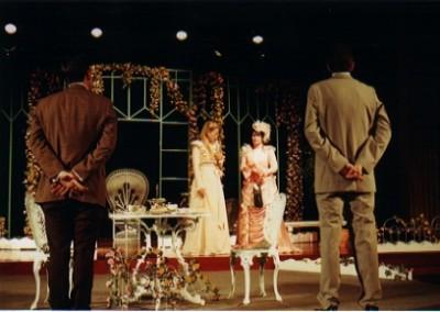 Gwendolen Fairfax (Lynsey Collis) and Cecily Cardew  (Elise Meleisea) ask where is their fianceé Earnest?