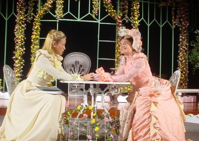 Gwendolen Fairfax (Lynsey Collis) and Cecily Cardew  (Elise Meleisea)get to know one another....