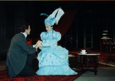 Jack (Robert Crowe) proposes to Gwendolen (Lynsey Collis)