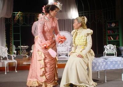 Gwendolen Fairfax (Lynsey Collis) and Cecily Cardew  (Elise Meleisea) confer.