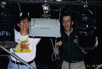 Michelle Zielinski and Rick Richards hang lights.