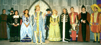Paul Robere as the King and the cast of AWEW.