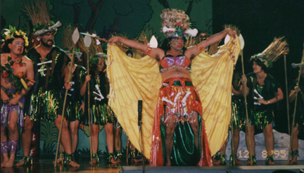"""Ismael Mercado as """"Wotta Woppa"""" Queen of the Cannibals with her tribe"""