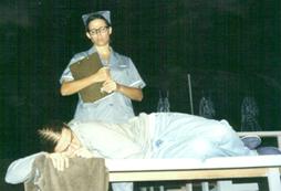 Jonathan Newton as Alan Strang, Michelle Zielinski as Nurse.