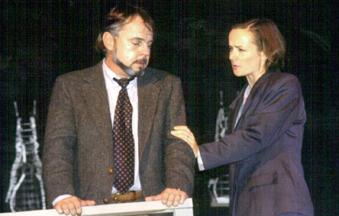 Patrick L'Argent as Martin Dysart; Caroline Lisser as Hesther Saloman