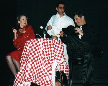 Louise Truslow (Sarah) and Daryl Morrissey (Sky Masterson) have a chat with the Cuban waiter (Surin Narula)